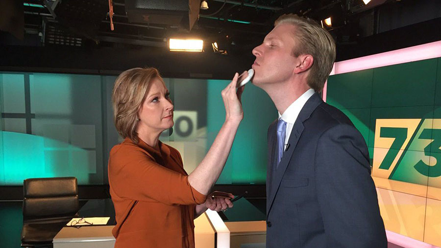 Leigh Sales puts make-up on Mark Humphries on the set of 7:30