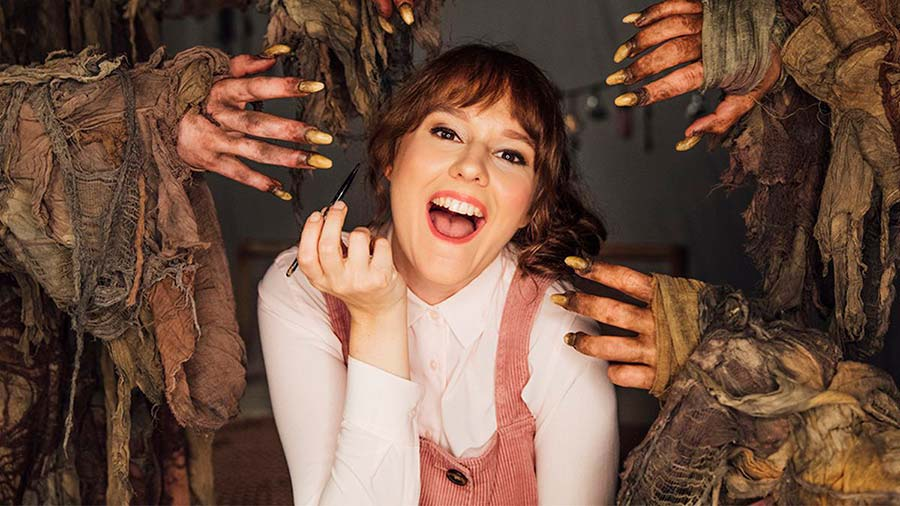 YouTube makeup blogger Sarah surrounded by the dirty hands of the mole people