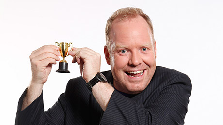 Peter Helliar holding a trophy