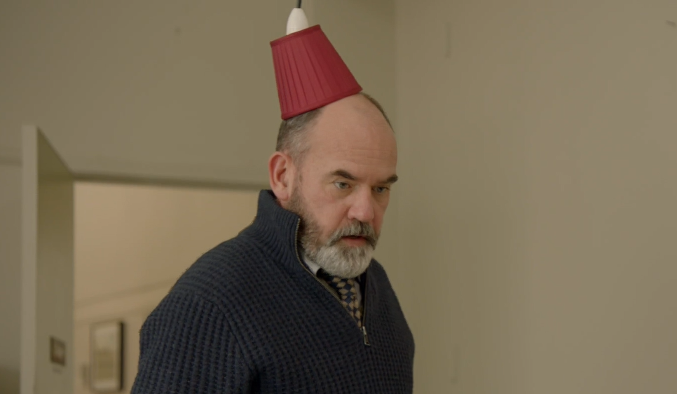 Ray Gruber (Marty Sheargold) with a fez-style lampshade on his head