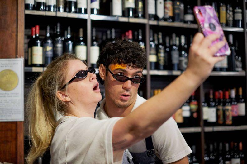 Iggy & Ace take a selfie in a wine shop